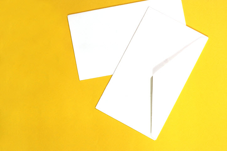 white envelopes and yellow background