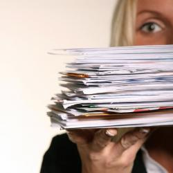 woman holding a pile of mail