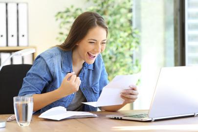 Woman viewing her mail online via USPS Informed Delivery