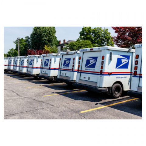 row of USPS trucks