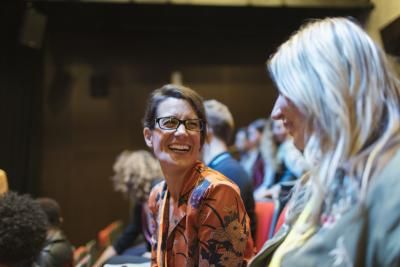 women networking and laughing at conference